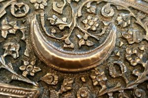 Kashmiri copper tray - an antique Northern Indian octagonal pierced copper tray or wall hanging, chased foliate & crescent moon detail