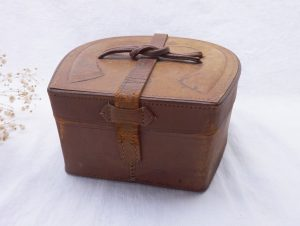 Antique leather collar box, horseshoe tan leather storage or craft box with strap closure, Edwardian / early 20th Century box for collars