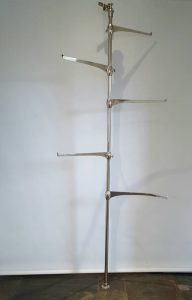 Art Deco tall clothing display rail from a shop