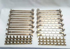 Antique brass window furniture - a rare high quality set of 24 brass casement stays, pins & rests by Gibbons of Wolverhampton, UK.